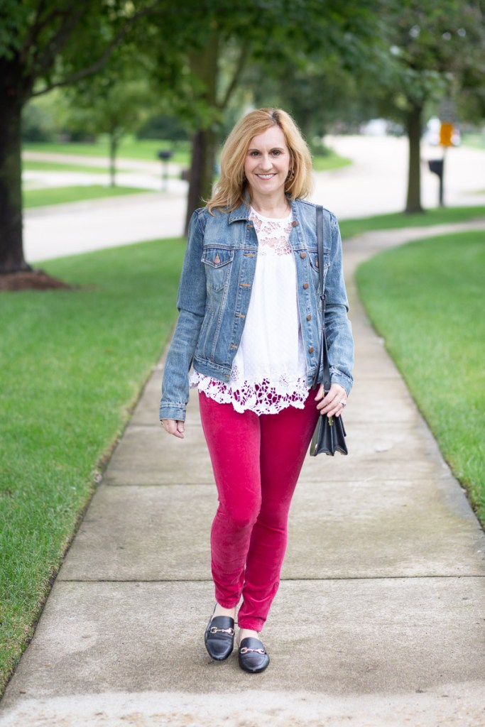 A casual look featuring a denim jacket, lace top and skinny corduroy pants.