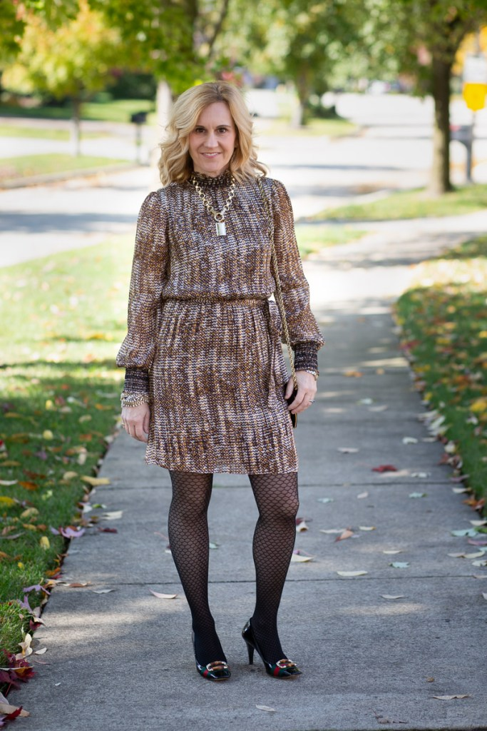 A printed dress by Daniel Rainn paired with textured tights and pumps.