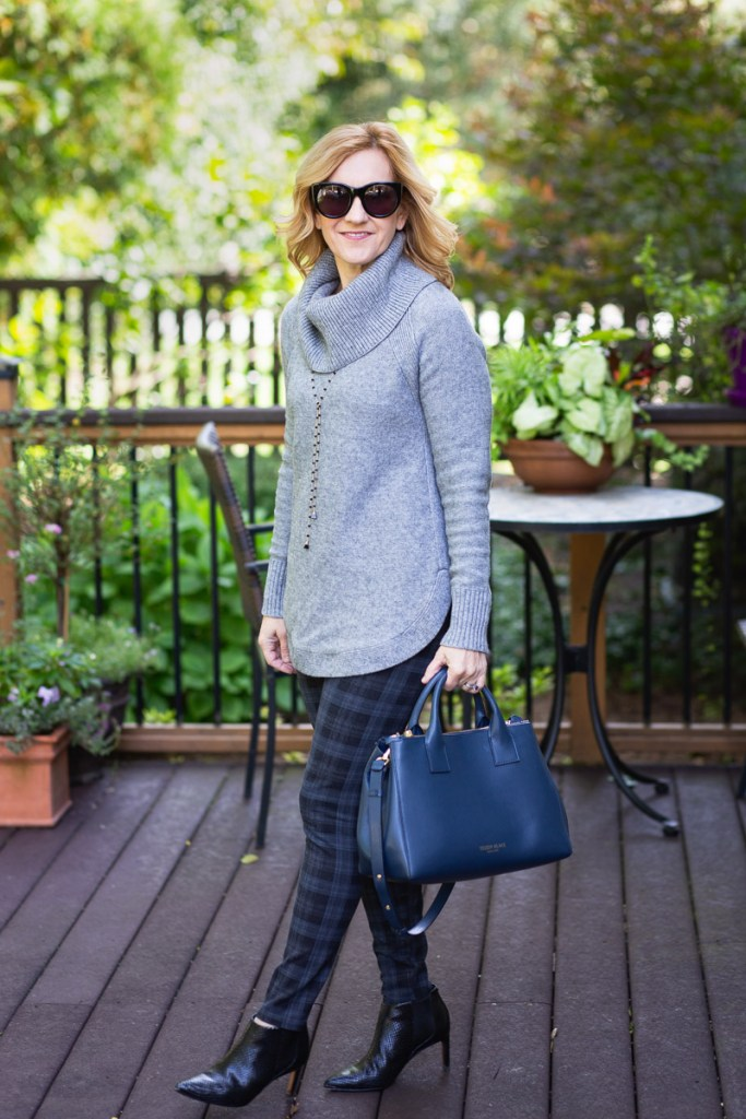 Pairing my favorite grey cowl neck sweater with plaid leggings and black booties.