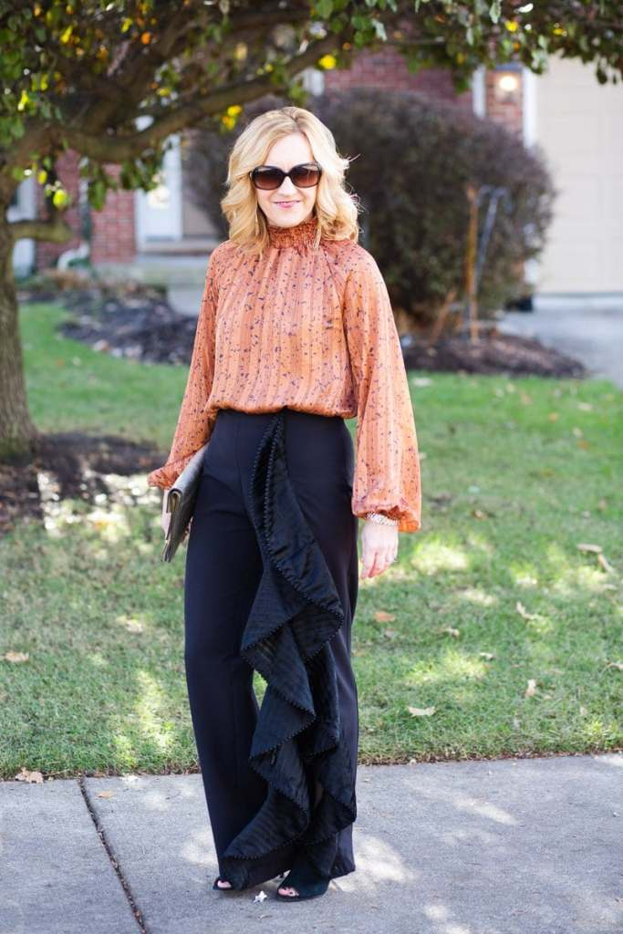 Styling my ruffle pants with a bodysuit for a chic holiday look.