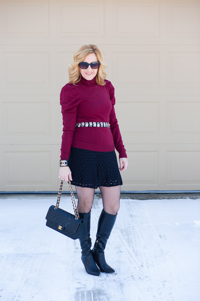 Layering a puff sleeve turtleneck over a little black dress.