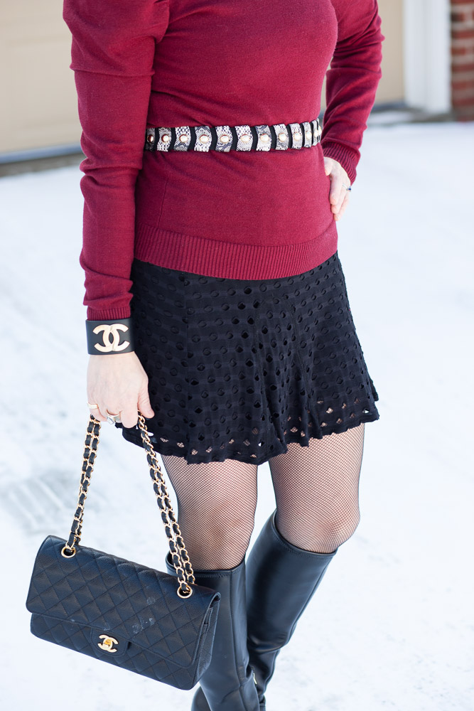 Dressing up a winter look with a snakeskin waist belt, a Chanel cuff, and a Chanel bag.