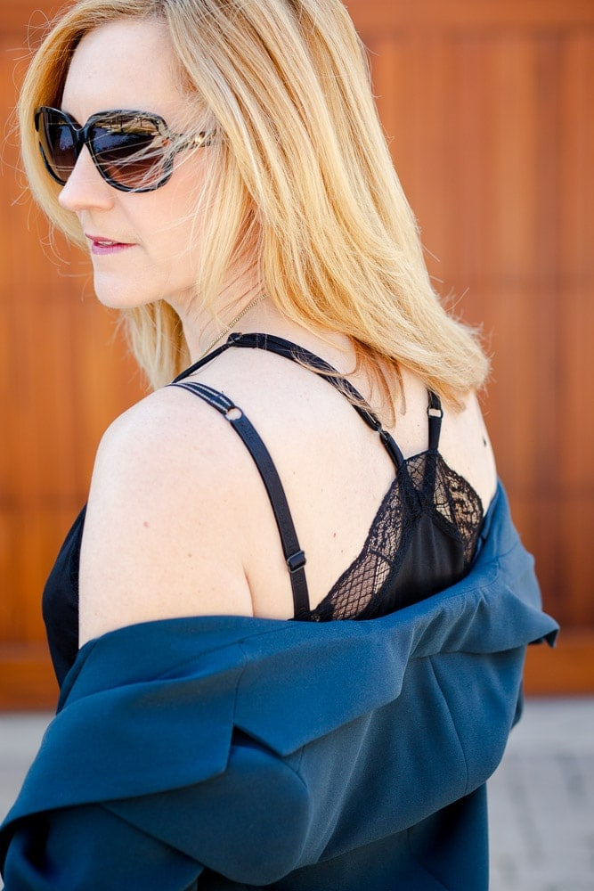Sharing the adjustable racerback detail of this lace camisole.