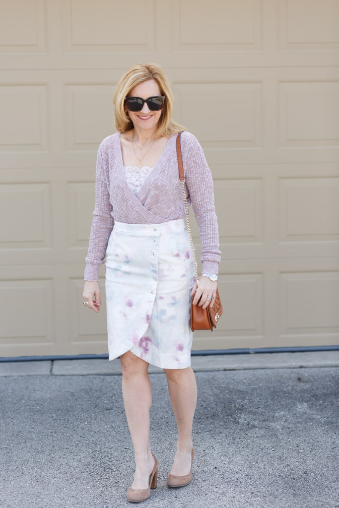Styling a tie-dyed tulip skirt with a lightweight pink sweater.