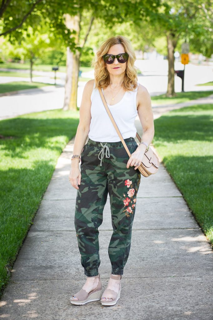 Styling floral embroidered joggers by Driftwood.