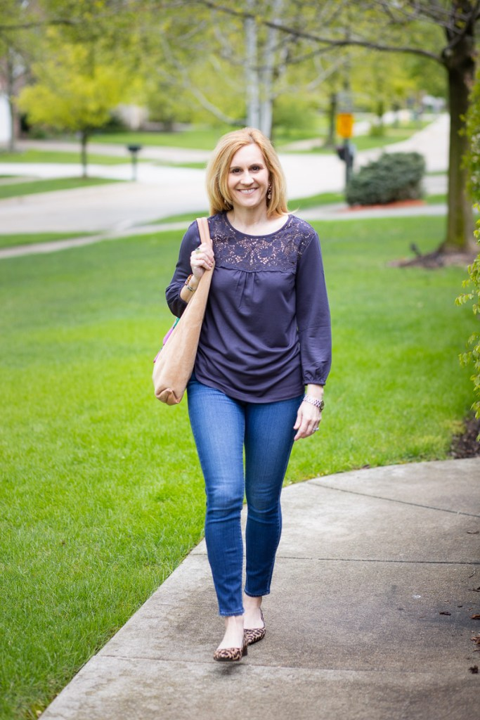 A charcoal lace blouse by Daniel Rainn paired with skinny jeans and leopard flats.