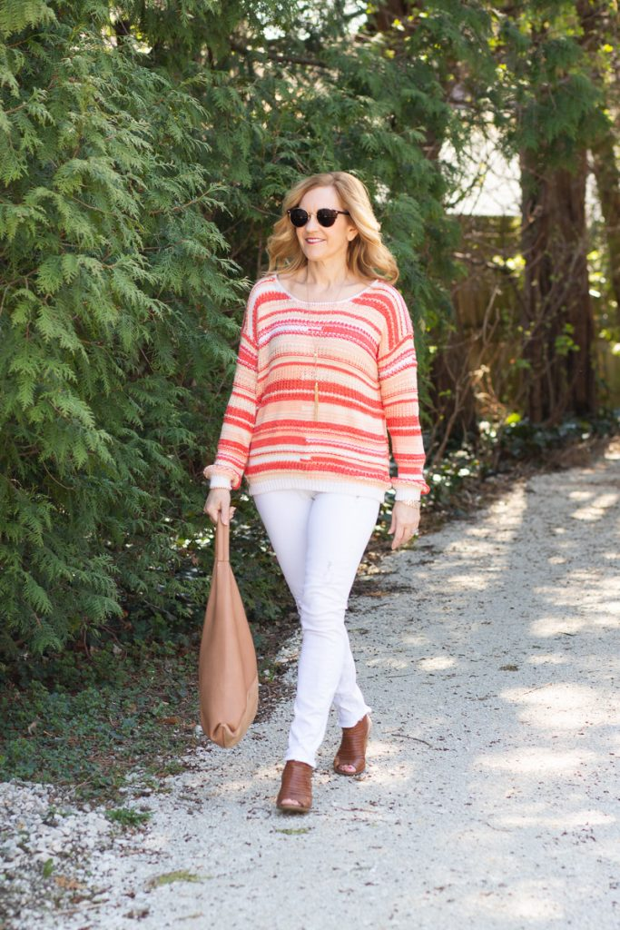 A spring striped sweater paired with white jeans.