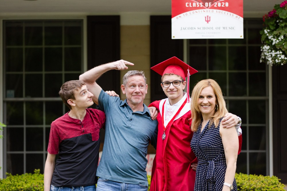Being silly with the high school graduate.