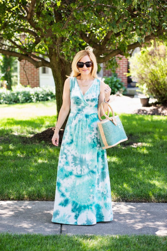 Wearing a green tie dye maxi dress.