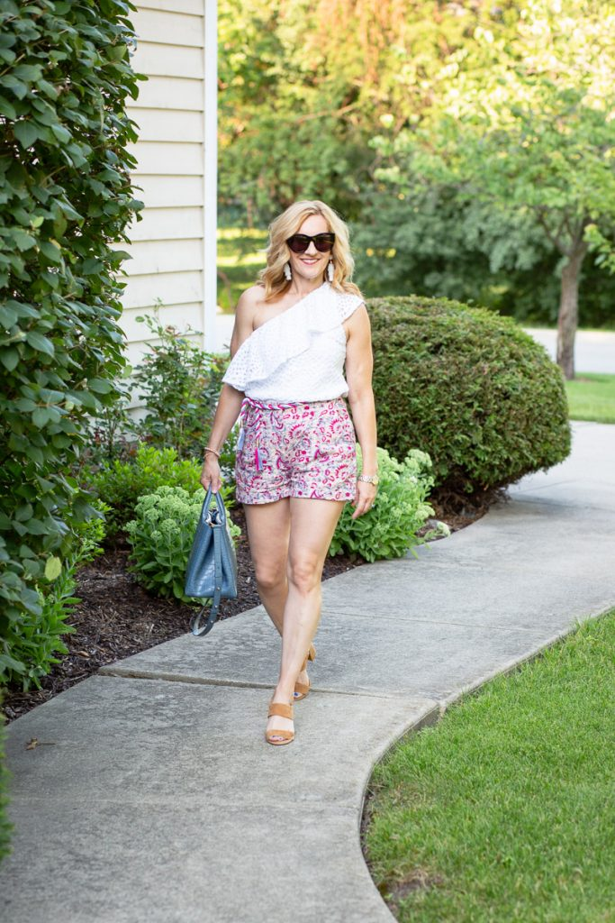 Pairing paisley linen shorts with a one shoulder ruffle top.
