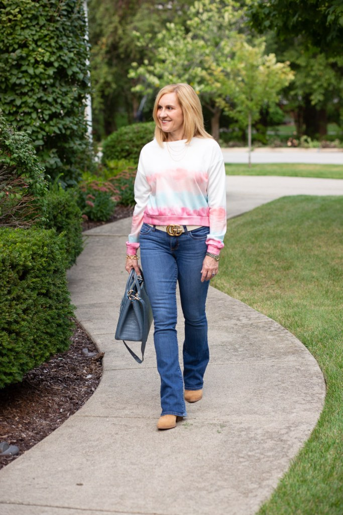 A polished casual look that features a tie dye cropped sweatshirt from Amazon.