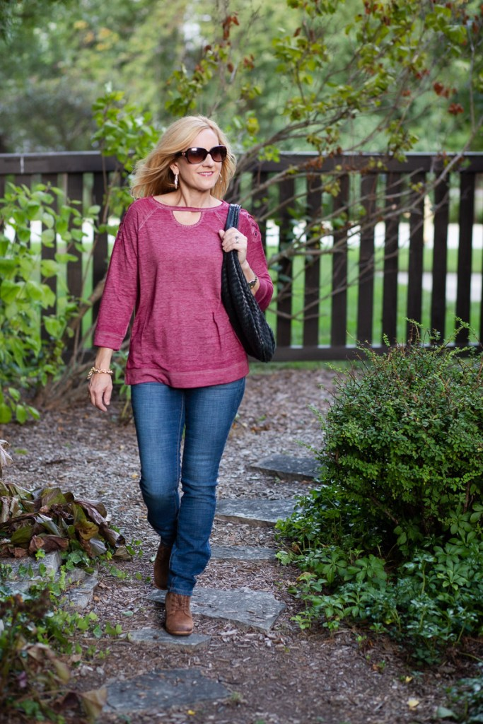 Pairing a wine colored top with bootcut jeans and suede booties.