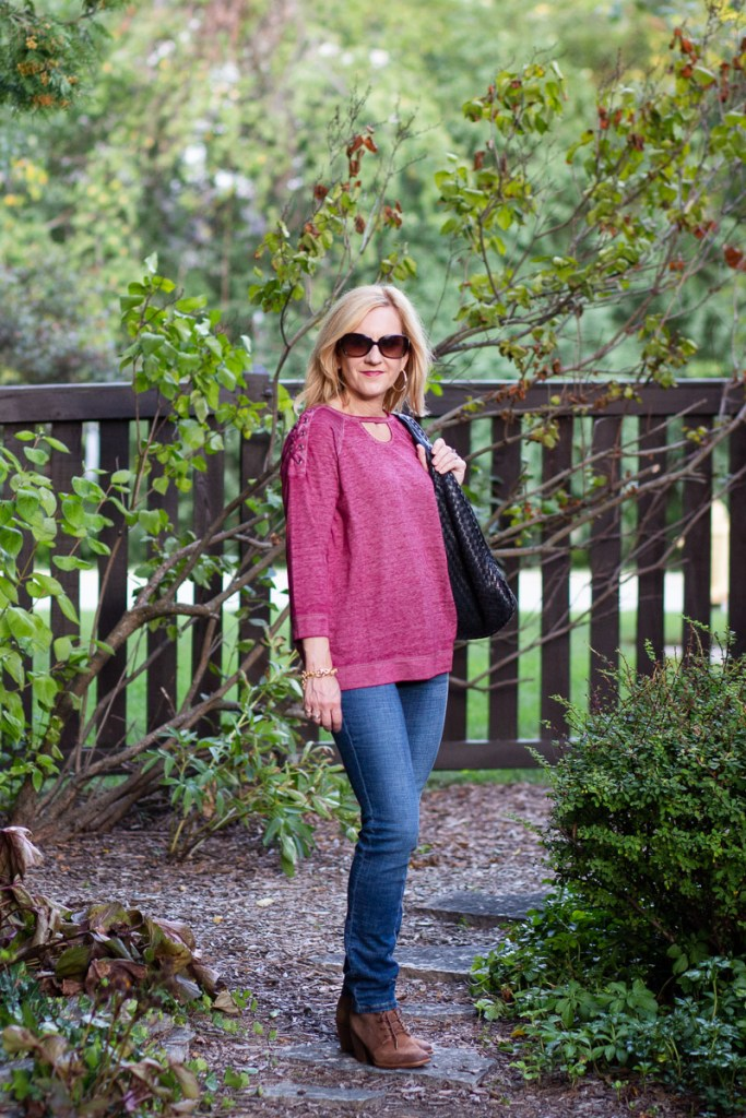 Wearing a lace up wine athleisure top from Cato Fashions.