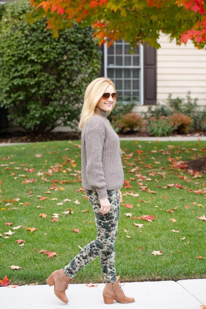 Styling a brown chunky sweater with camouflage corduroy pants and suede lace up booties.