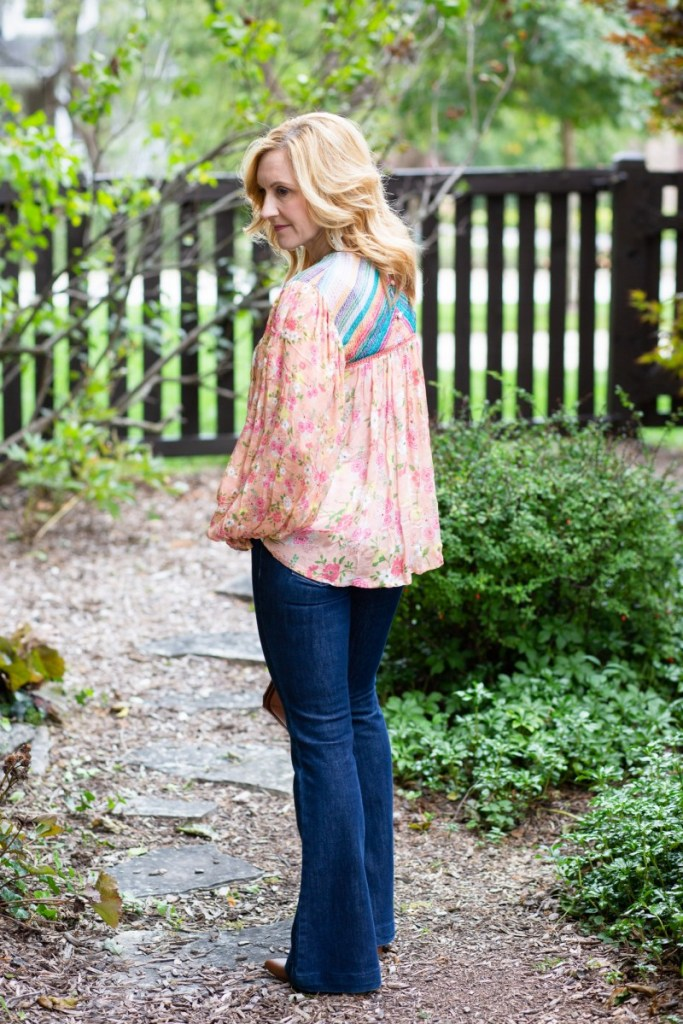 View of the back of this blissful babydoll boho floral blouse.