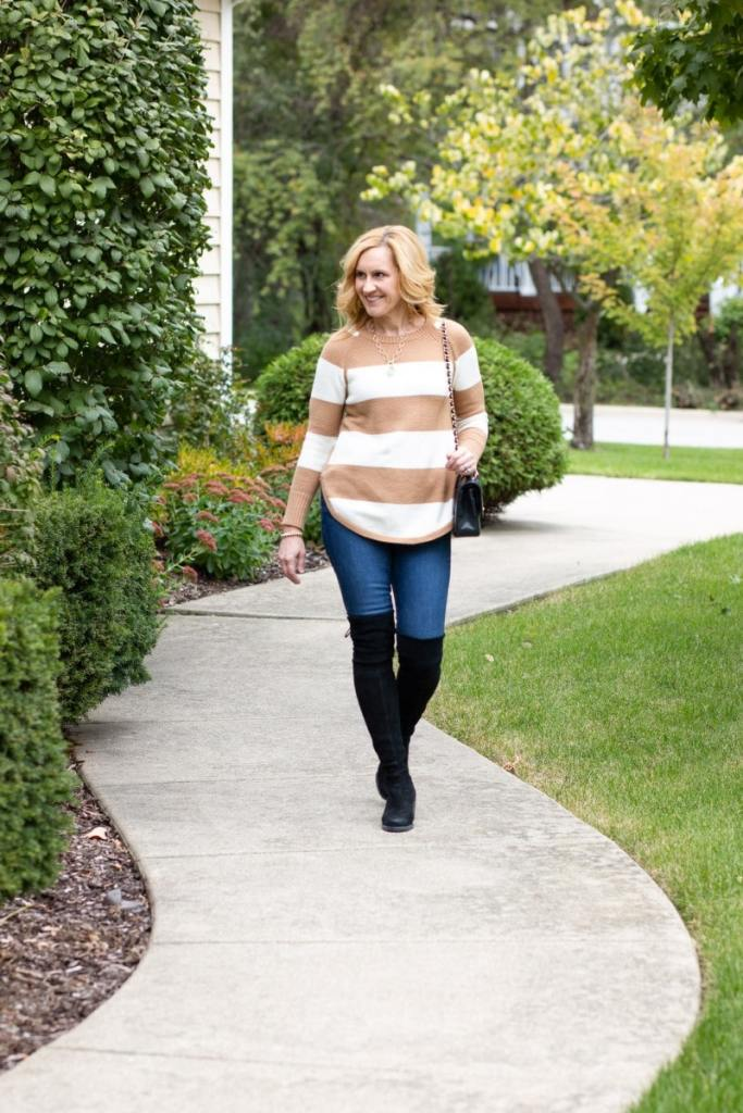 My fall uniform which consists of a sweater tunic with skinny jeans and over the knee boots.