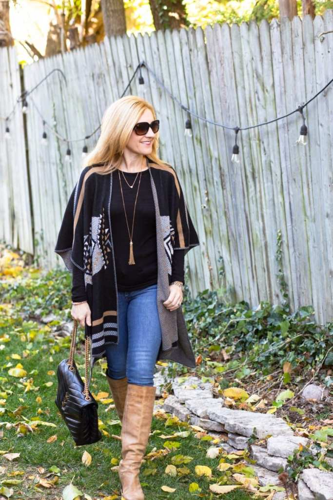Staying cozy with this poncho sweater, skinny jeans, and knee boots outfit.
