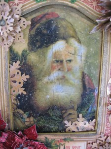 Close up of Santa and frame from Christmas Past collection.  Note the antiqued, cracked glass effect.