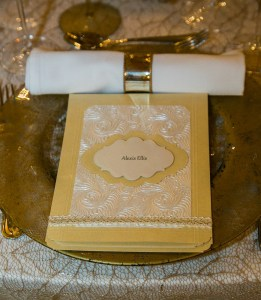 I combined luxurious ivory glimmer paper with an embossed handmade paper in cream to set the tone of elegant simplicity in this opulent ballroom.