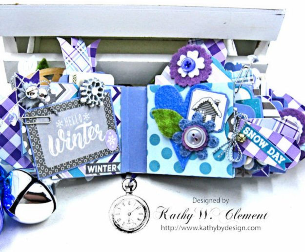 Frosty Winter Mini Tag Album Tutorial by Kathy Clement for Tammy Tutterow Designs Product by Spellbinders and Authentique Photo 10
