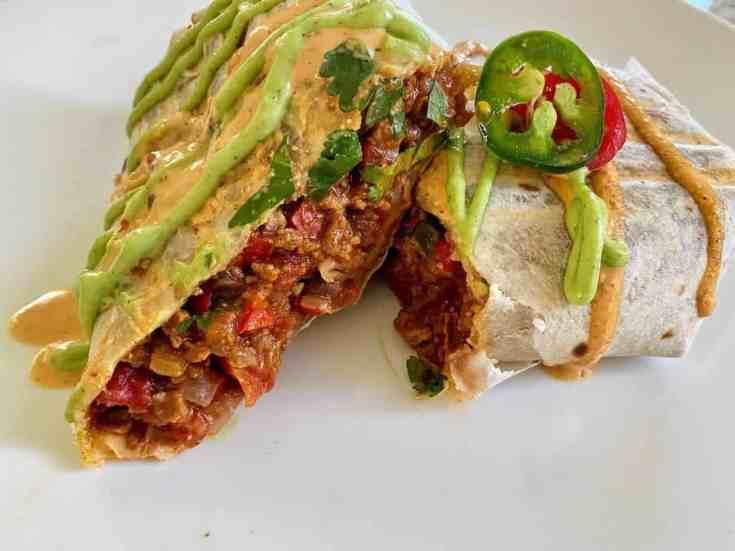 Ultimate burrito cut in half