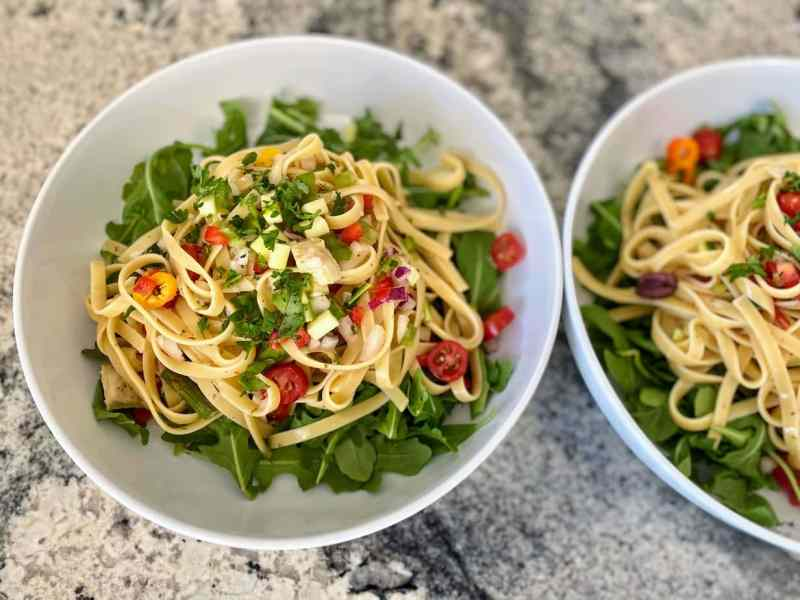 spagetti salad on arugula