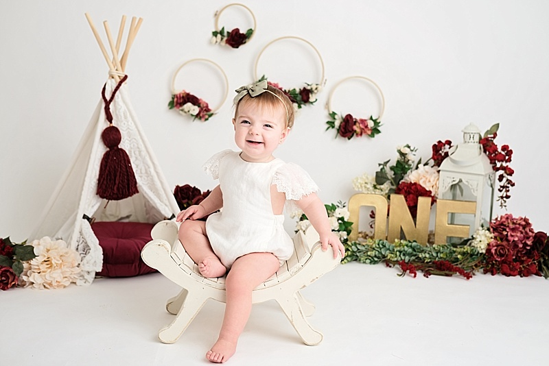 red and gold girl first birthday session
