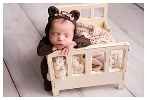 newborn baby in bear outfit
