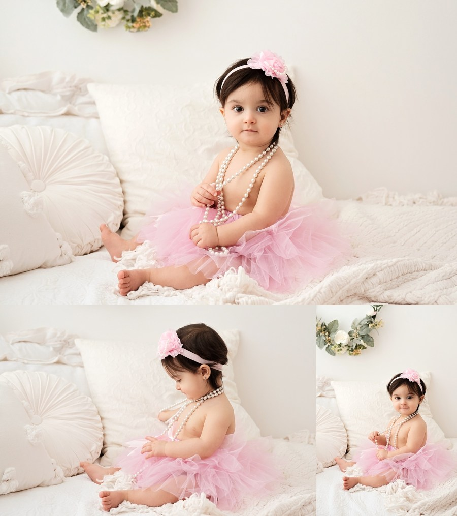 one year old with pink headband