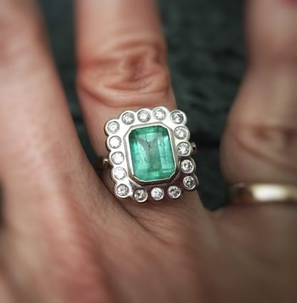 Vintage 14kt WG Columbian Emerald and Diamond Bezel Set Halo Engagement Ring