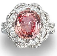 A padparadscha sapphire and diamond ring.