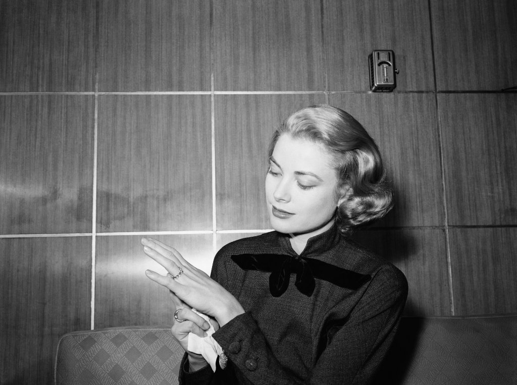 Grace Kelly admiring her first engagement ring.