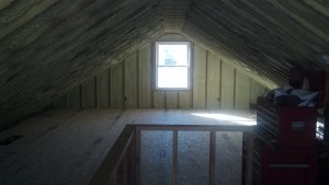Similar view...now with subfloor, duct work hidden, and a half wall framed out around the staircase.