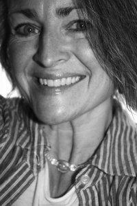 Kim Woodward Osterholzer headshot author and midwife
