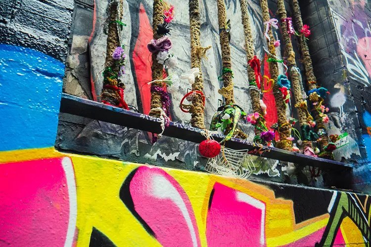 Image of ribbons tied on railings street art in Melbourne
