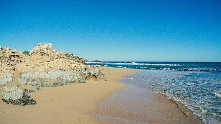 Image of sandy beach and blue sea on Penguin Island near Perth Western Australia