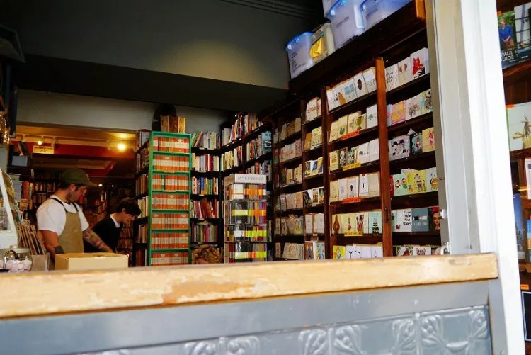 Image of bookshelves and counter inside Gertrude & Stein cafe in Sydney