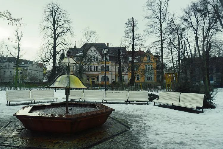 Image of fountain in snow-covered park in Sopot Poland