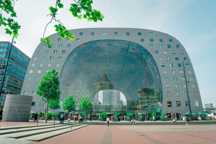 Image of the arch-shaped Markthal building in Rotterdam with glass panels at both ends