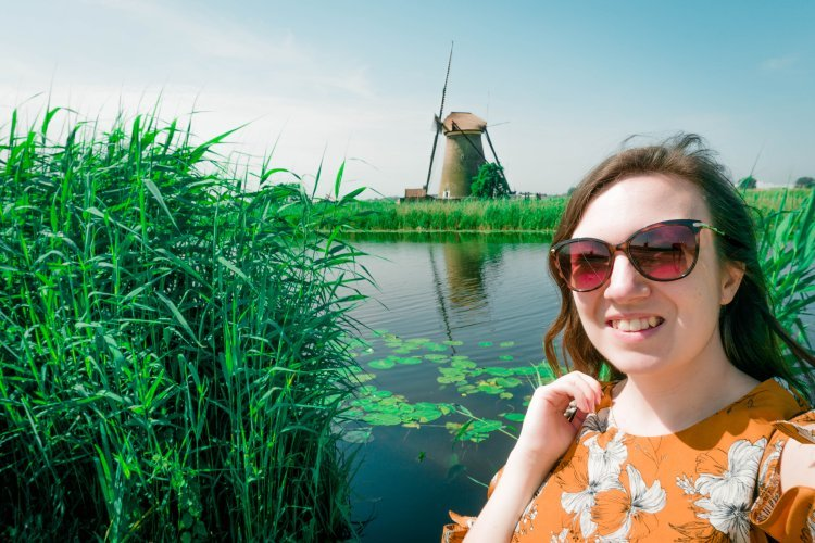 Image of me (Kat) in from of Kinderdijk windmill