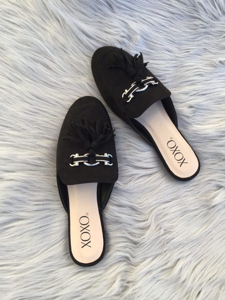 The tassels add details on these black suede mules
