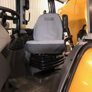 To show a canvas seat cover for a Caterpillar Backhoe