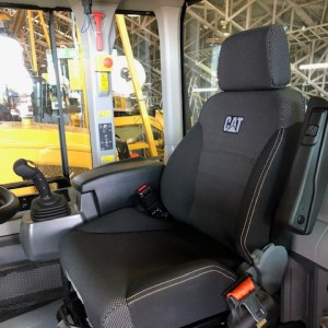 To show a canvas seat cover for a Caterpillar Loader
