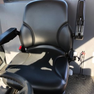 To show a canvas seat cover for a Dynapac Vibratory Compactor