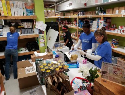 Kauffman associates volunteer together