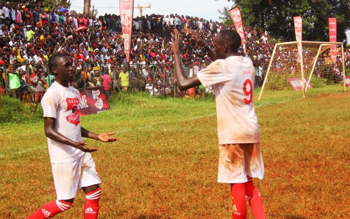 The passionate crowd to push the home team all the way #Uganda Aaron Okwii shirt 9 is congragulated by the teammate