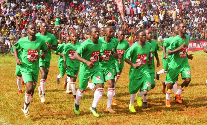 The passionate crowd to push the home team all the way #Uganda Jinj SS players players during a limbering session
