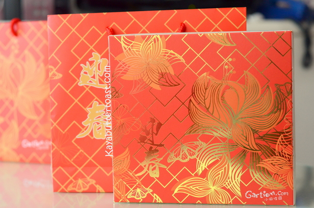 the red gold packaging this year is very striking and elegant at the same time the theme is peony or called as mudan flowers