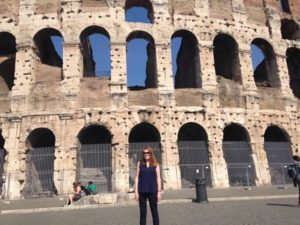 woman with narcolepsy in front of the Colosseum in Rome