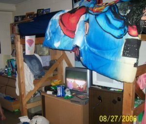 messy dorm room with loft bed